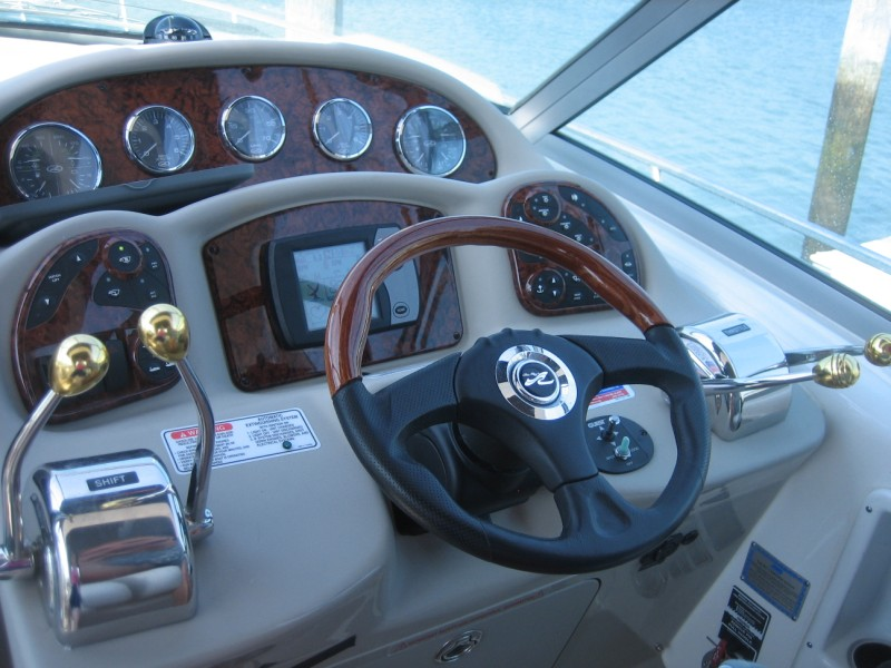 The Helm, showing Raymarine E80 Chartplotter w/24nm Radar and Northstar VHF Radio
