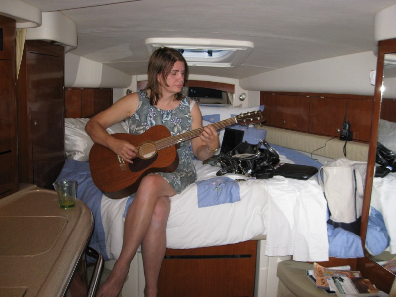 Playing guitar on the bunk (all-mahogony Martin 00-15)